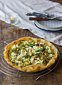 Crispy zucchini pie with fresh goat cheese and toasted pine nuts