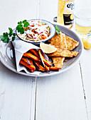 Breaded whiting fillets, sweet potato fries and shredded crisp vegetable salad