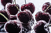 Red ripe cherries with water drops on wet surface