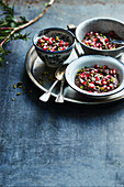 Full-bodied chocolate mousse with pomegranate and pistachios