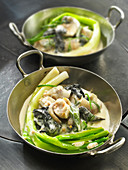 Whelks in mustard sauce with spring leeks and black mushrooms