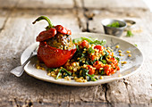 Red bell pepper stuffed with kefta, spinach wheat and cherry tomatoes