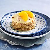 Pancake mille-feuille with orange jam