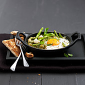 Shirred eggs with pesto and green beans