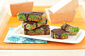 Pistachio cereal bars coated with dark chocolate