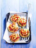 Diced bacon and shrimp mini pizzas