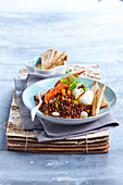 Lentil salad with a poached egg and crisp bacon