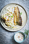 Fried fish with potato and fennel salad