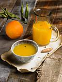 Orange and turmeric juice with black pepper
