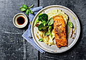 Salmon steak with mashed potatoes and broccoli