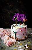 Geburtstagstorte mit Meerjungfrauen-Dekoration