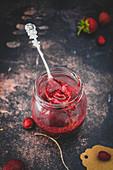 Jam jar of homemade strawberry jam
