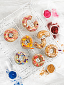 Donuts decorated with colored pigments