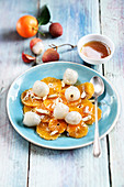Clementine salad with lychees, almonds and vanilla syrup