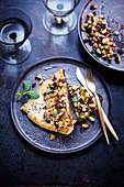Swordfish with raisins, pine nuts, eggplant a la plancha