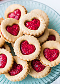 Heart-shaped raspberry jam biscuits