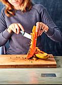 Woman carving a papaya