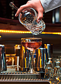 Bartender preparing a cocktail