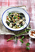 Small marinated squid with olive oil,peppers,olives and garlic