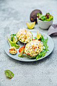 Avocado stuffed with crab,egg and tomato
