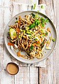 Sauted noodles with vegetables and lime