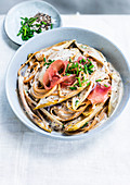 Spaghetti with chicory and cured ham