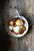 Cobbler with plums and vanilla ice cream