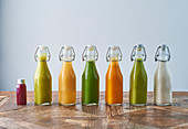 Assorted bottles of detox juice with fruits and vegetables