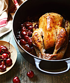 Guinea-fowl with cherries