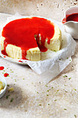 Fresh cheese cake with strawberry coulis