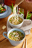 Chicken and pea broth with parmesan