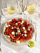 Watermelon a la plancha with cherries and mozzarella