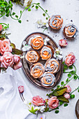Muffins with icing rose petals