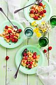 Fruit salad with melon, raspberries, pistachios, mint and honey