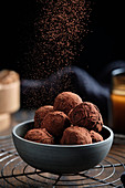 Vegan dairy-free chocolate truffles, rolled in melted chocolate and dusted with cocoa powder