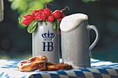 Bavarian snack, two beer mugs and pretzels on a table, Bavaria, Germany, Europe