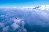 Hot air balloon over the clouds, Upper Bavaria, Germany