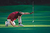 Male Golfer preparing