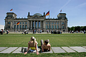 Young people in front of German Reichstag, Berlin, Germany