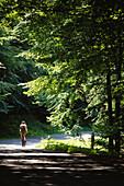 Cycling young woman, Jasmund Nationalpark, Ruegen, Germany