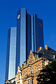 High rise building of the Deutsche Bank and residential house under blue sky, Frankfurt, Hesse, Germany, Europe