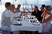 People are at table on a sailing boat, Caribbean, America
