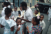 Salesman giving children ice cream, St. Lucia, Caribbean