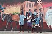 Four boys in front of graffitti in Castries, St. Lucia, Caribbean