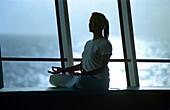 Woman doing Yoga, Cruise ship AIDA, Caribbean, America