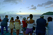Tourists standing at banister, Cruise liner Aida