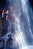 People climping through waterfall, Falls of Balleine, St. Vincent, Caribbean