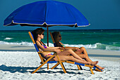 Women under a sunshade on the beach, Panama City, Florida, USA, America