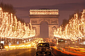 The illuminated Champs Elysees at night, Paris, France, Europe