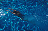 Woman diving in a pool at La Manga Resort, Spain, Europe